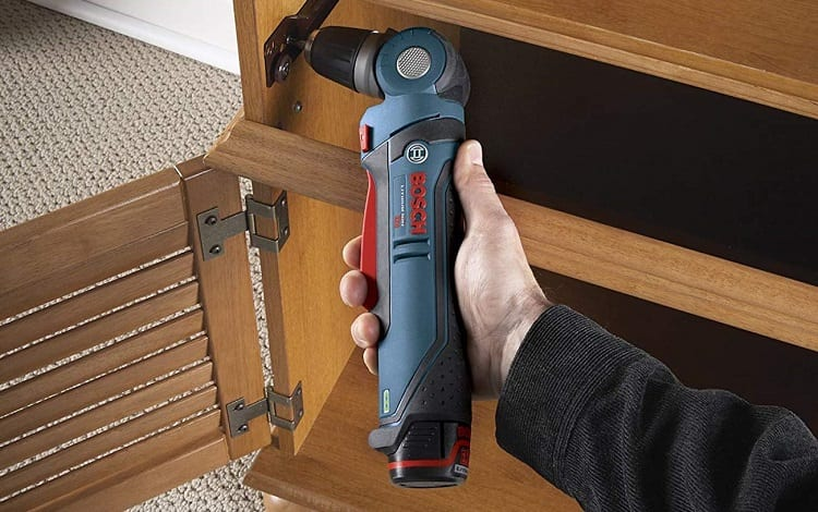 fixing door in kitchen element with angle drill