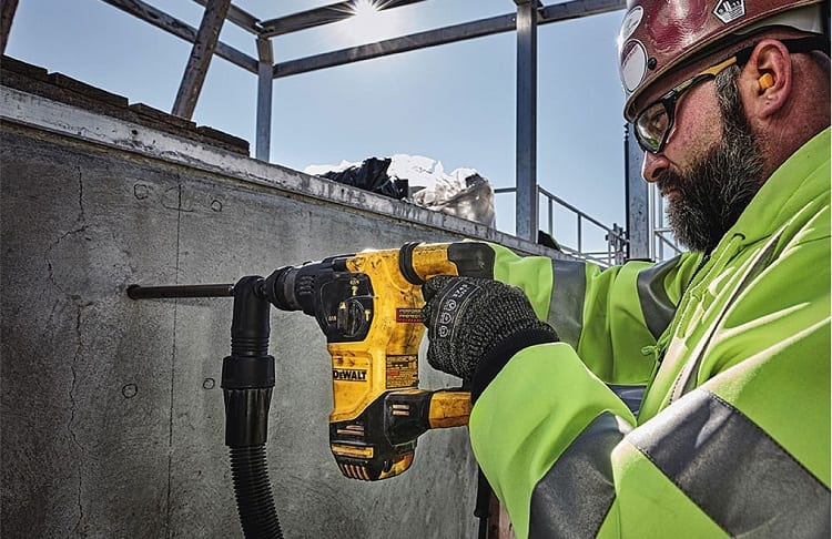 hammer drill with construction worker