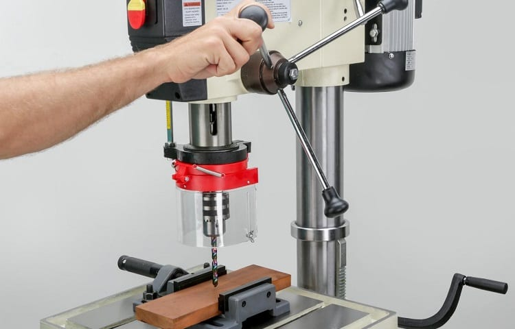 hand operates drill press