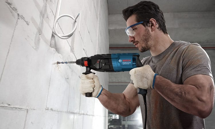drilling wall with corded drill