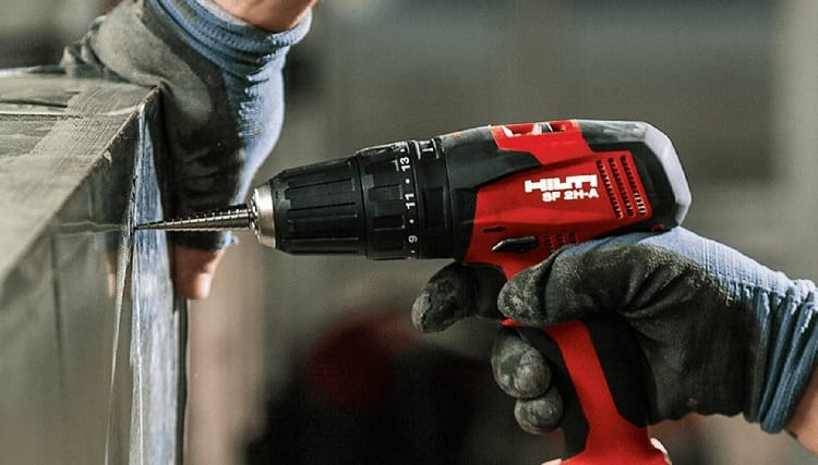 red cordless drill and drilling bit