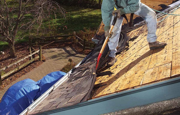 removing roof tiles with shovel